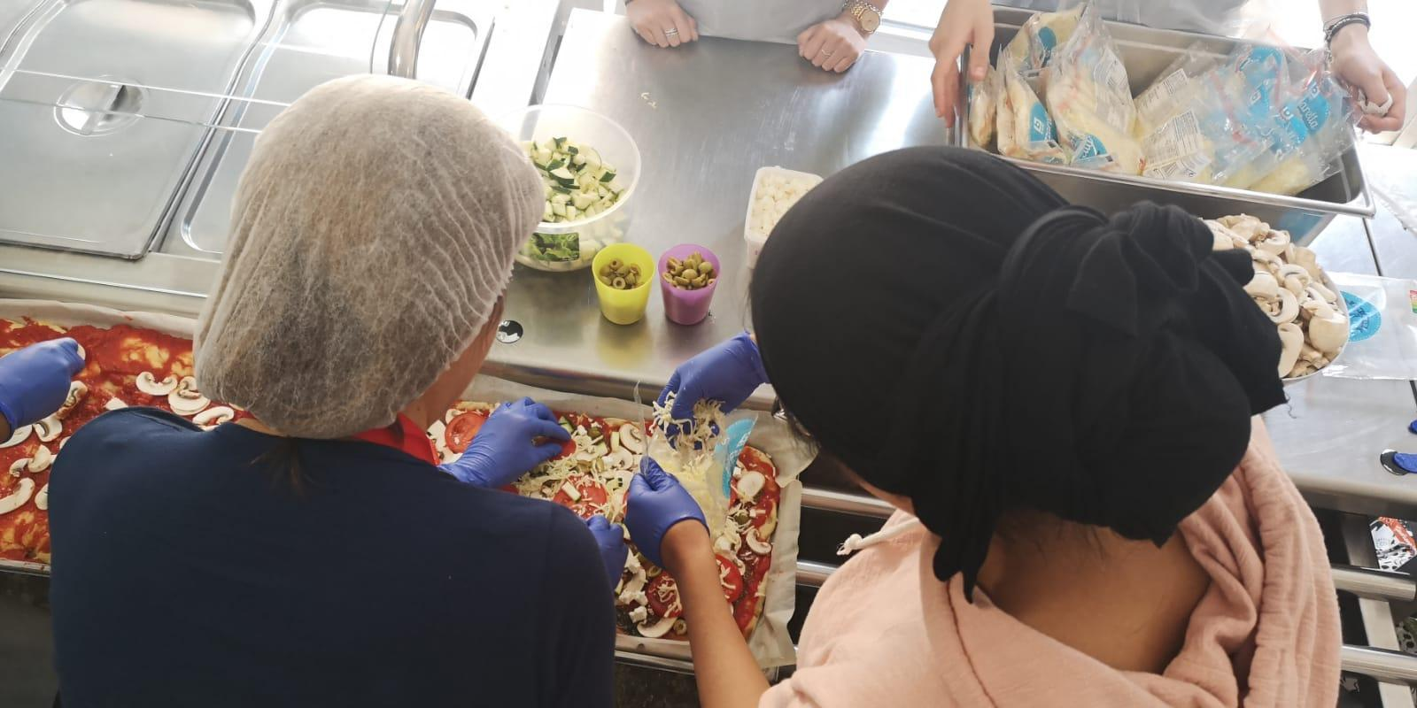 Pizza-making with the women at the Jette centre